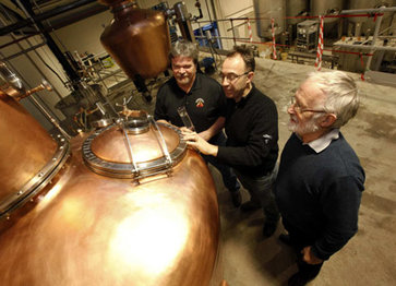 Mark Coffman from Alltech in the United States, Seamus O'Hara from Carlow Brewing Company and Jack O'Shea from Alltech Ireland, with the spirit still. Photo courtesy of Alltech / Carlow Brewing Co.